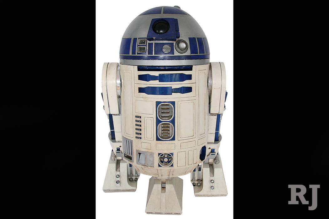 This 2017 photo provided by Profiles in History shows an R2-D2 droid pieced together over several years from different props used in the first five Star Wars movies. The droid has sold at auction  ...