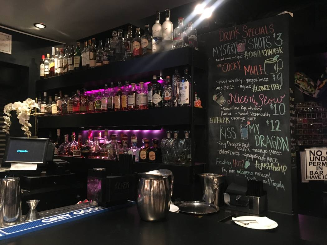 Mundo at Mingo has a full-service bar complete with built-in phone chargers for its patrons. (Katelyn Umholtz/Las Vegas Review-Journal) @kumh0ltz