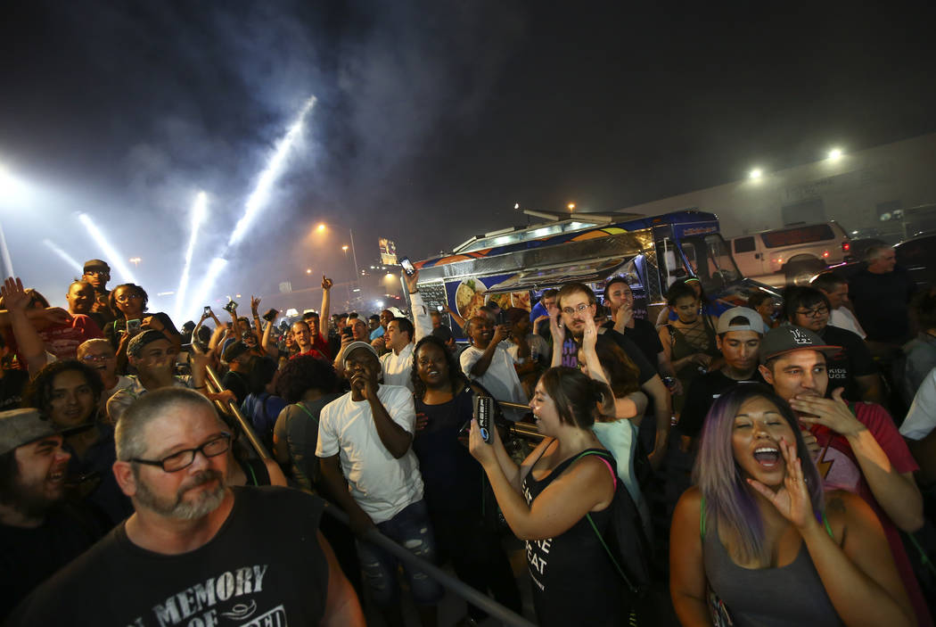 Customers cheer as the clock turns to midnight allowing  for the purchase of recreational marijuana at Reef Dispensaries in Las Vegas on Saturday, July 1, 2017. Chase Stevens Las Vegas Review-Jour ...
