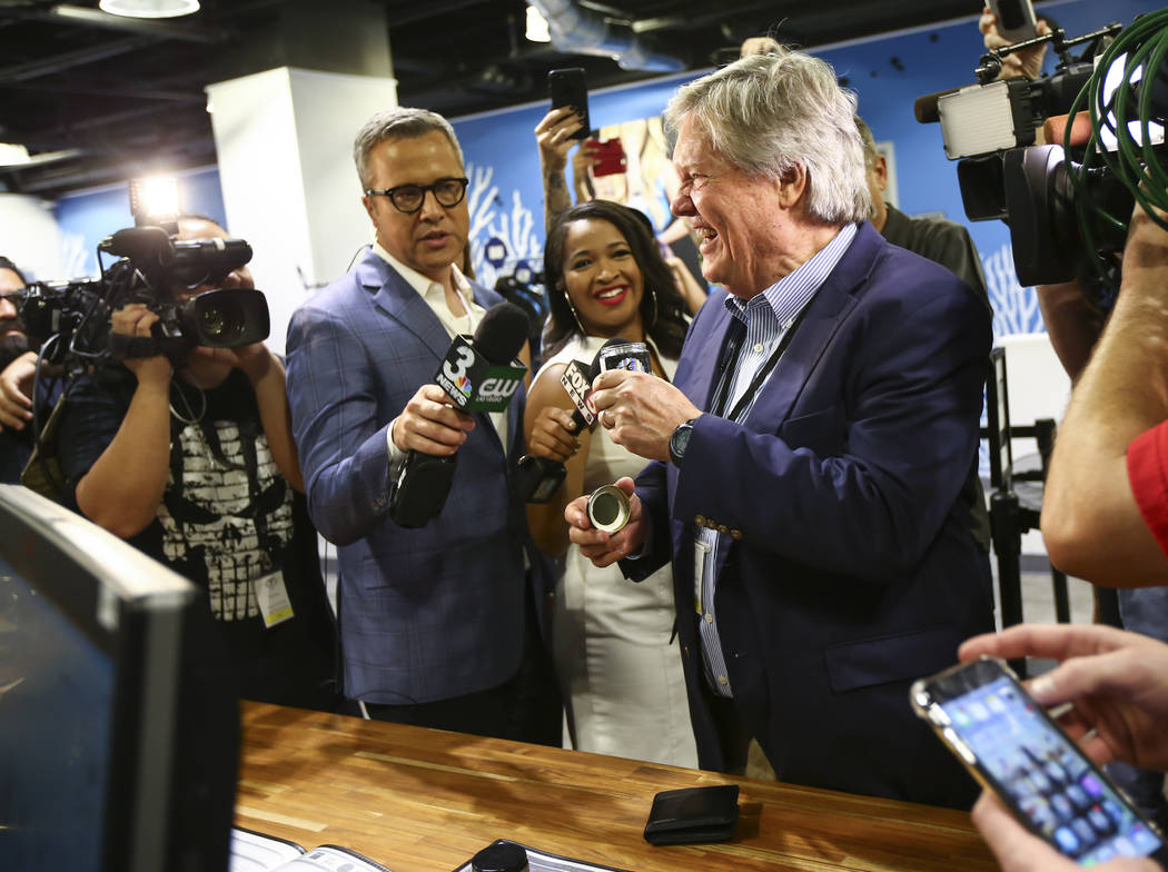 Sen. Tick Segerblom, D-Las Vegas, checks out marijuana before being the first customer to buy recreational marijuana at Reef Dispensaries in Las Vegas on Saturday, July 1, 2017. Chase Stevens Las  ...