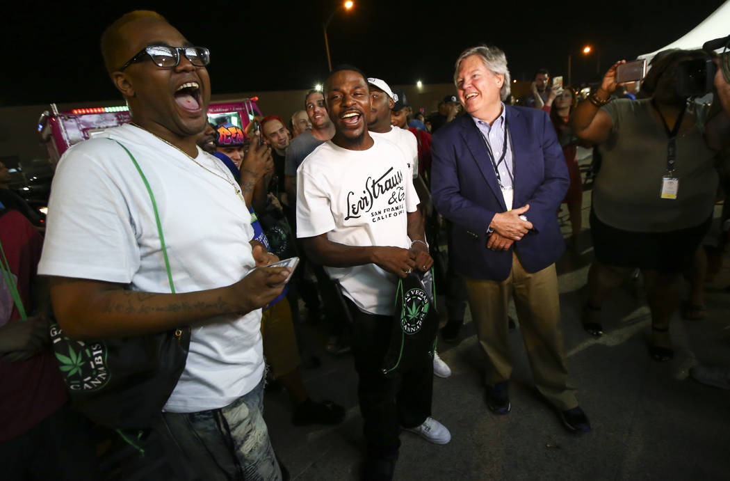 Sen. Tick Segerblom, D-Las Vegas, right, joins, Armahn Diamond, left, and Raynard White in line to purchase recreational marijuana from Reef Dispensaries in Las Vegas on Friday, June 30, 2017. Cha ...