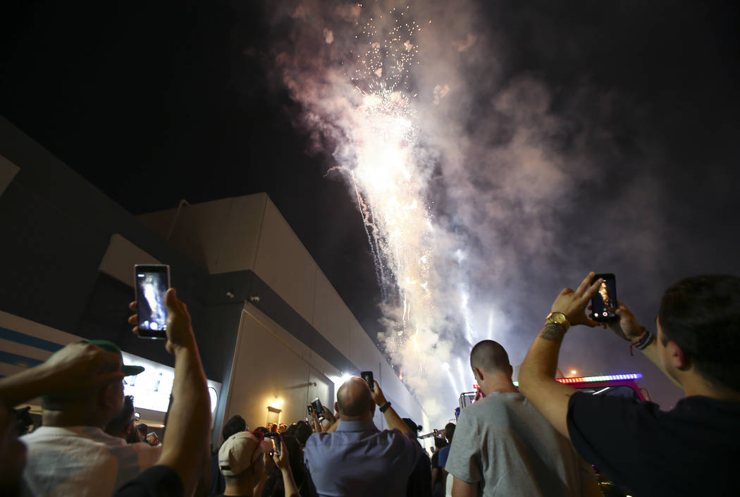 Fireworks go off as customers line up to be some of the first people to legally purchase recreational marijuana at Reef Dispensaries in Las Vegas on Friday, June 30, 2017. Chase Stevens Las Vegas  ...