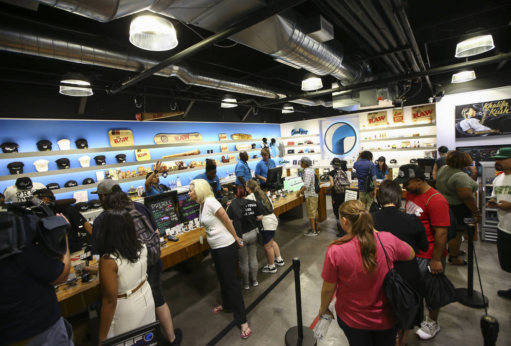 Customers line up to be some of the first to legally purchase recreational marijuana at Reef Dispensaries in Las Vegas on Saturday, July 1, 2017. Chase Stevens Las Vegas Review-Journal @csstevensphoto