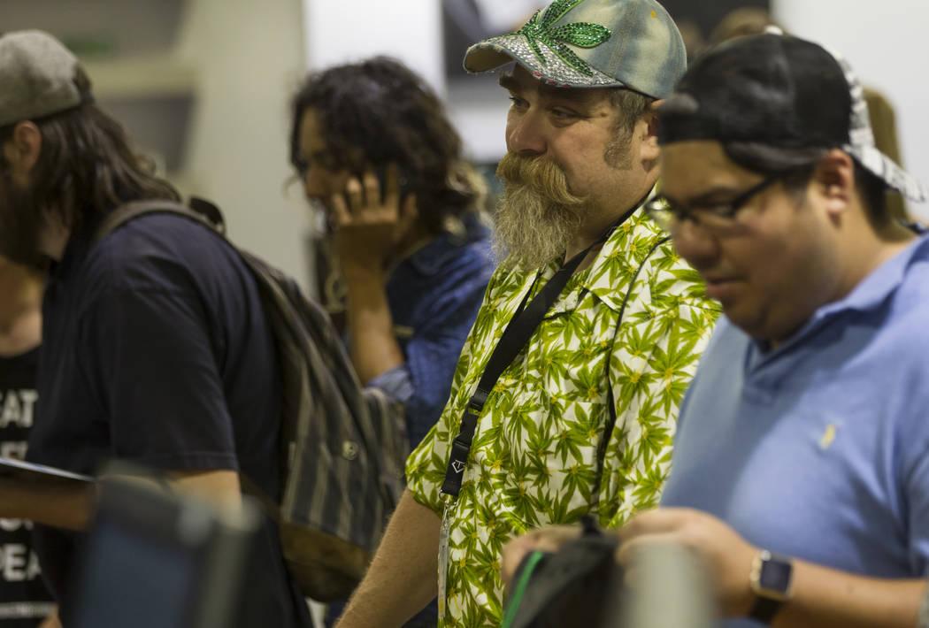 Leslie Bocskor looks through marijuana items as recreational sales become legal in Nevada at Reef Dispensaries in Las Vegas on Saturday, July 1, 2017. Chase Stevens Las Vegas Review-Journal @csste ...