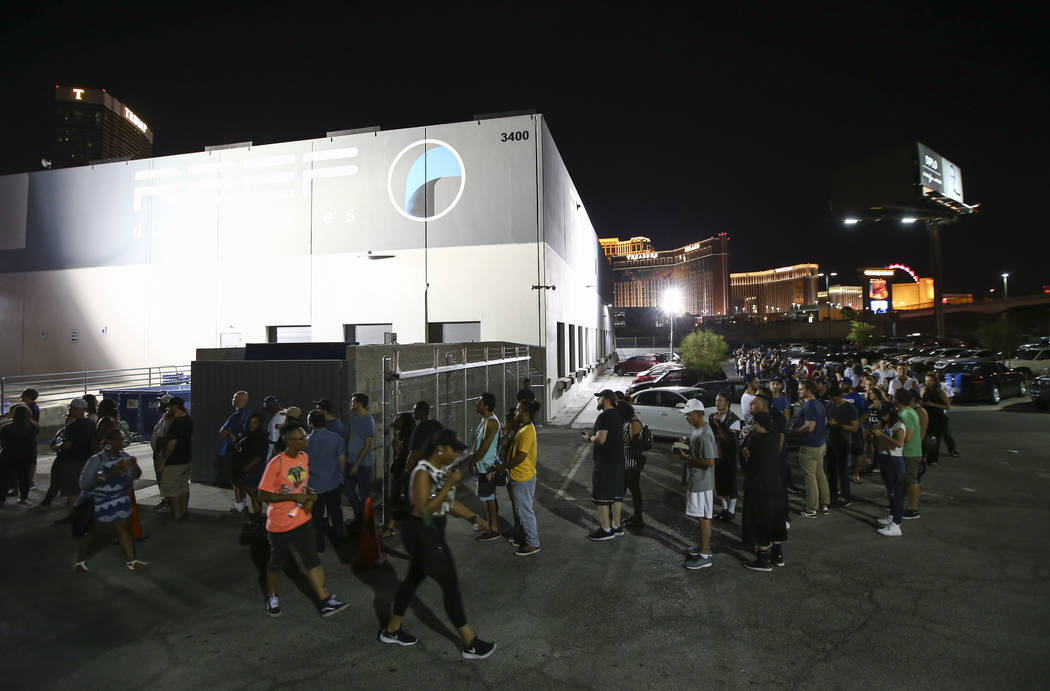 Customers line up to be some of the first to legally purchase recreational marijuana at Reef Dispensaries in Las Vegas on Friday, June 30, 2017. Chase Stevens Las Vegas Review-Journal @csstevensphoto