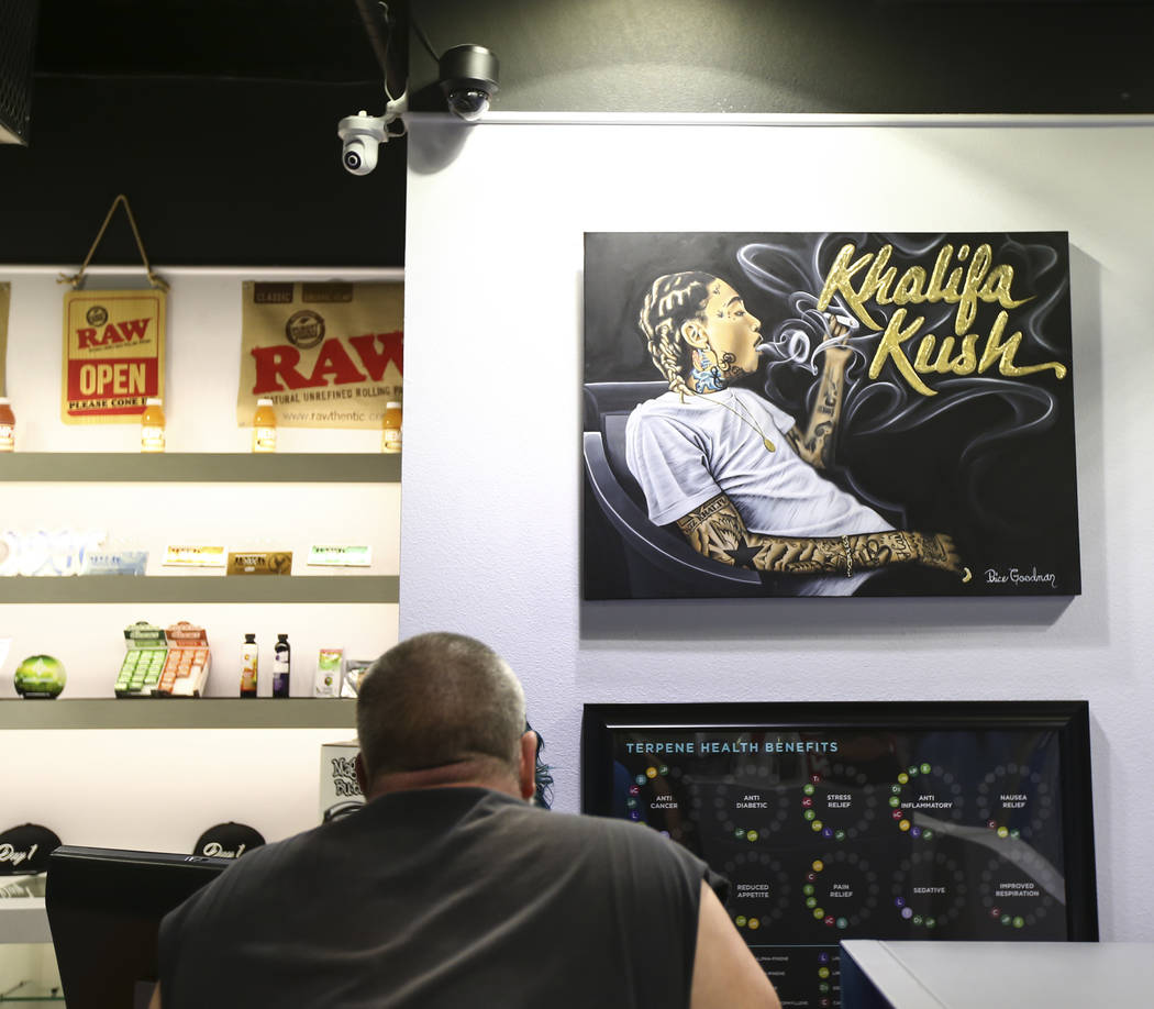 A customer looks through marijuana items as recreational sales become legal in Nevada at Reef Dispensaries in Las Vegas on Saturday, July 1, 2017. Chase Stevens Las Vegas Review-Journal @csstevens ...