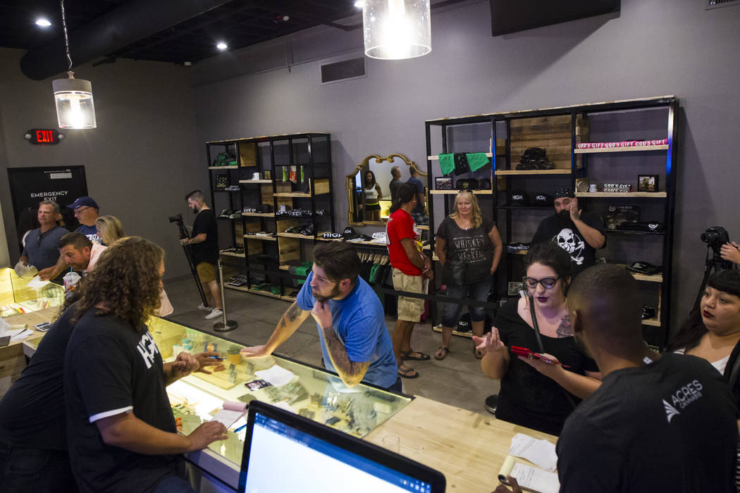 Budtender Tom Nieves, left, assists customer Ethan, of Henderson, during the first day of recreational marijuana sales at Acres Cannabis in Las Vegas on Saturday, July 1, 2017. Chase Stevens Las V ...