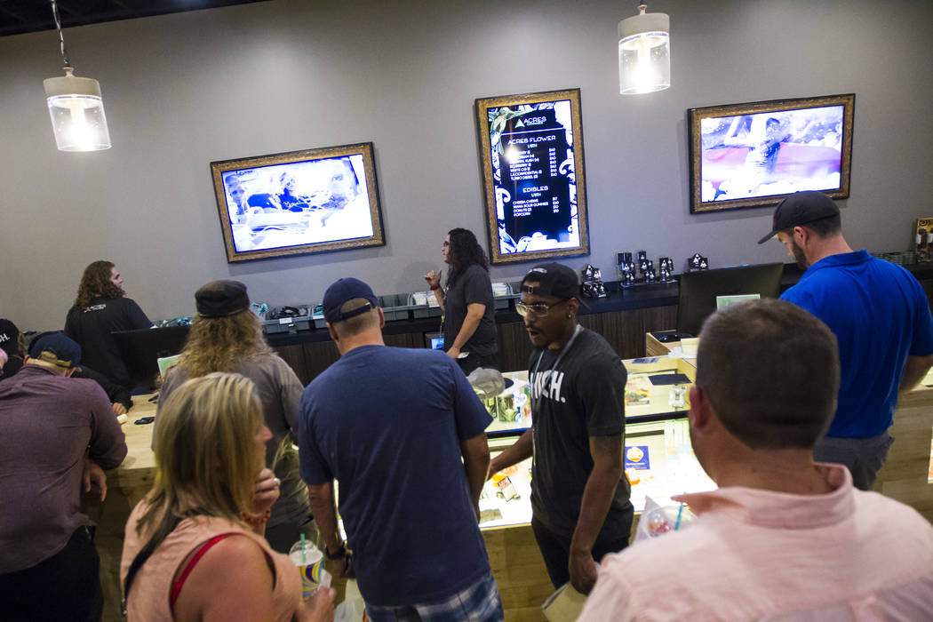 Customers browse through marijuana products during the first day of recreational sales at Acres Cannabis in Las Vegas on Saturday, July 1, 2017. Chase Stevens Las Vegas Review-Journal @csstevensphoto
