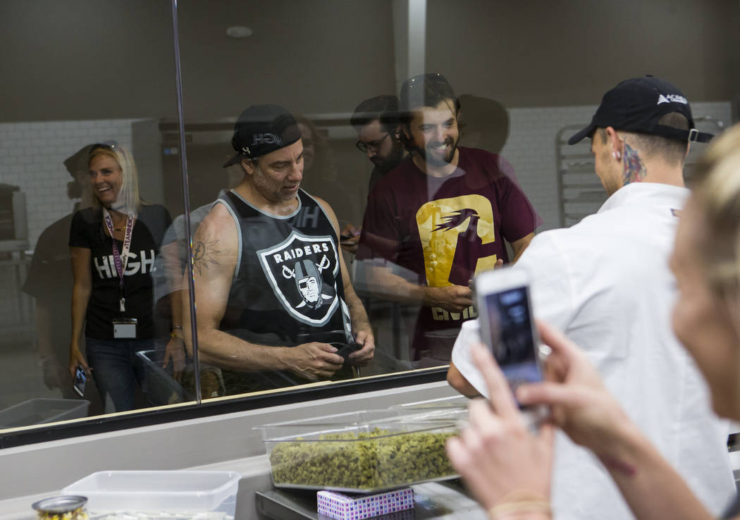 Customers take a look at the kitchen area at Acres Cannabis during the first day of recreational sales in Las Vegas on Saturday, July 1, 2017. Chase Stevens Las Vegas Review-Journal @csstevensphoto