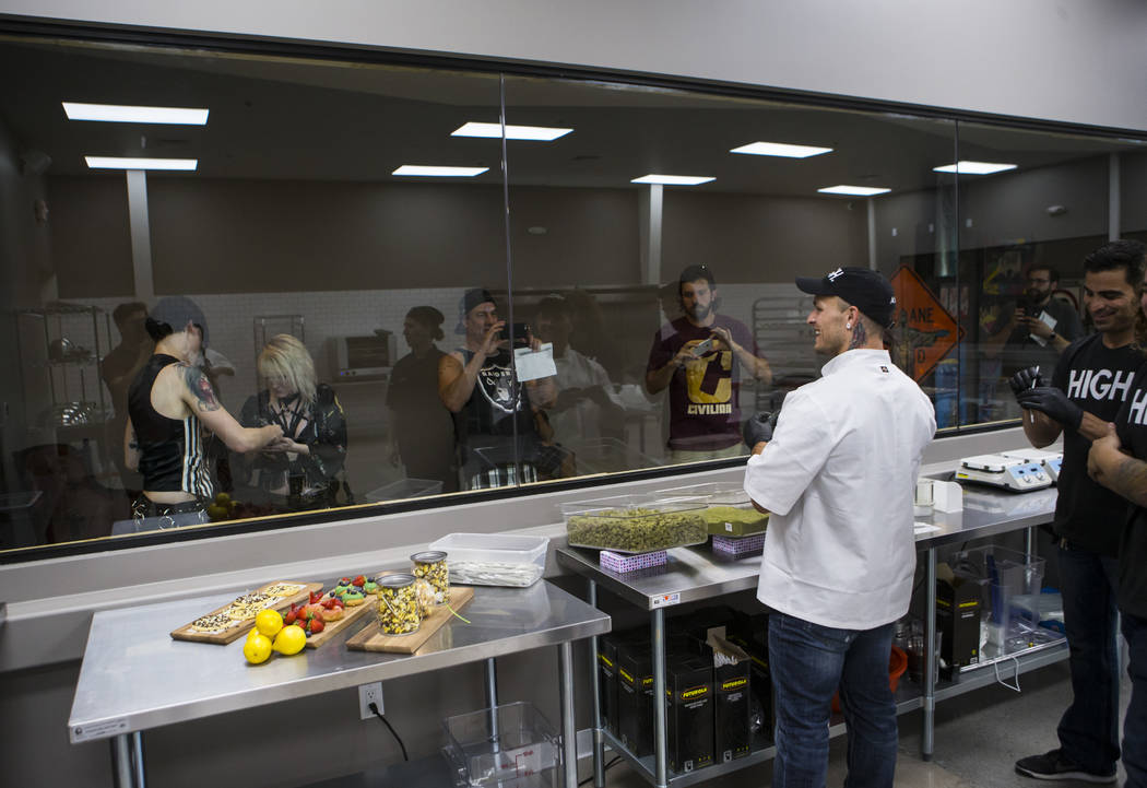Anthony Hubbard, center right, prepares rolled joints in the kitchen area at Acres Cannabis during the first day of recreational sales in Las Vegas on Saturday, July 1, 2017. Chase Stevens Las Veg ...