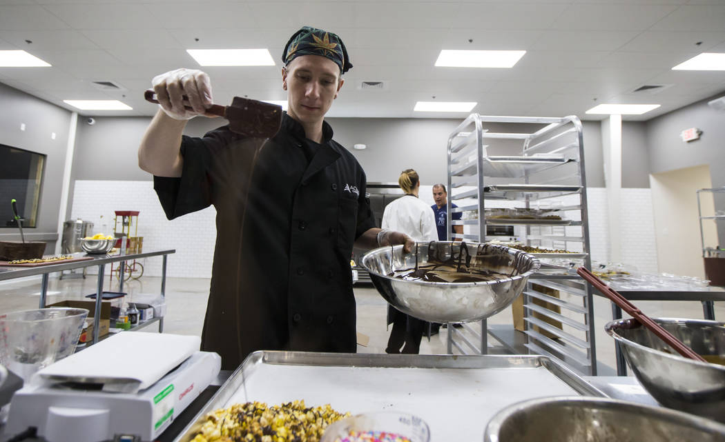 Brian Orr works on making edible marijuana products in the kitchen area at Acres Cannabis during the first day of recreational sales in Las Vegas on Saturday, July 1, 2017. Chase Stevens Las Vegas ...