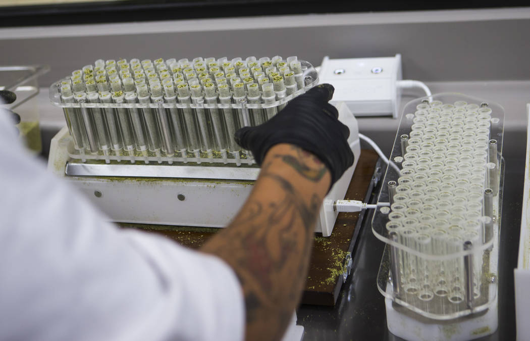 Anthony Hubbard prepares rolled joints in the kitchen area at Acres Cannabis during the first day of recreational sales in Las Vegas on Saturday, July 1, 2017. Chase Stevens Las Vegas Review-Journ ...