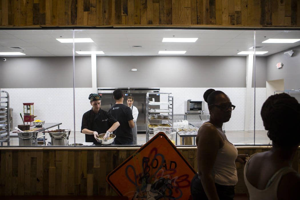 Brian Orr, left, works on making edible marijuana products in the kitchen area at Acres Cannabis during the first day of recreational sales in Las Vegas on Saturday, July 1, 2017. Chase Stevens La ...