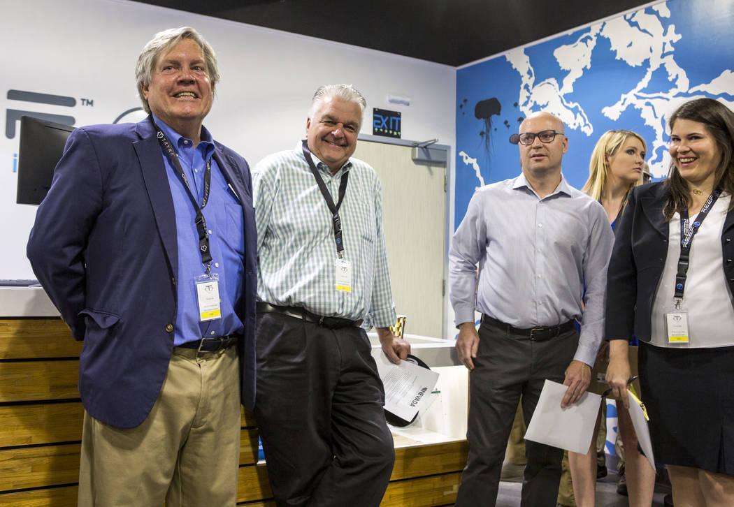 Sen. Tick Segerblom, D-Las Vegas, from left, Clark County Commission Chairman Steve Sisolak, Andrew Jolley, president of the Nevada Dispensary Association, and Riana Durrett, the association's exe ...