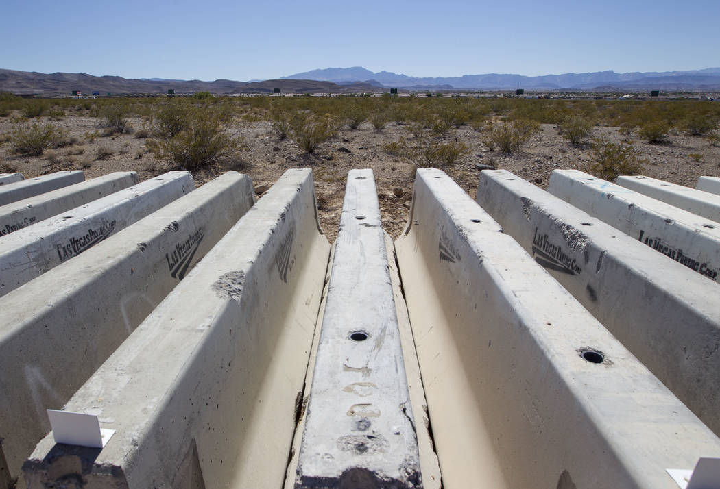 Rows of concrete road barriers sit on a parcel of land on the west side of Las Vegas Boulevard between Siddall Avenue and Chartan Avenue on Friday, June 30, 2017. An investor group from the Bay Ar ...