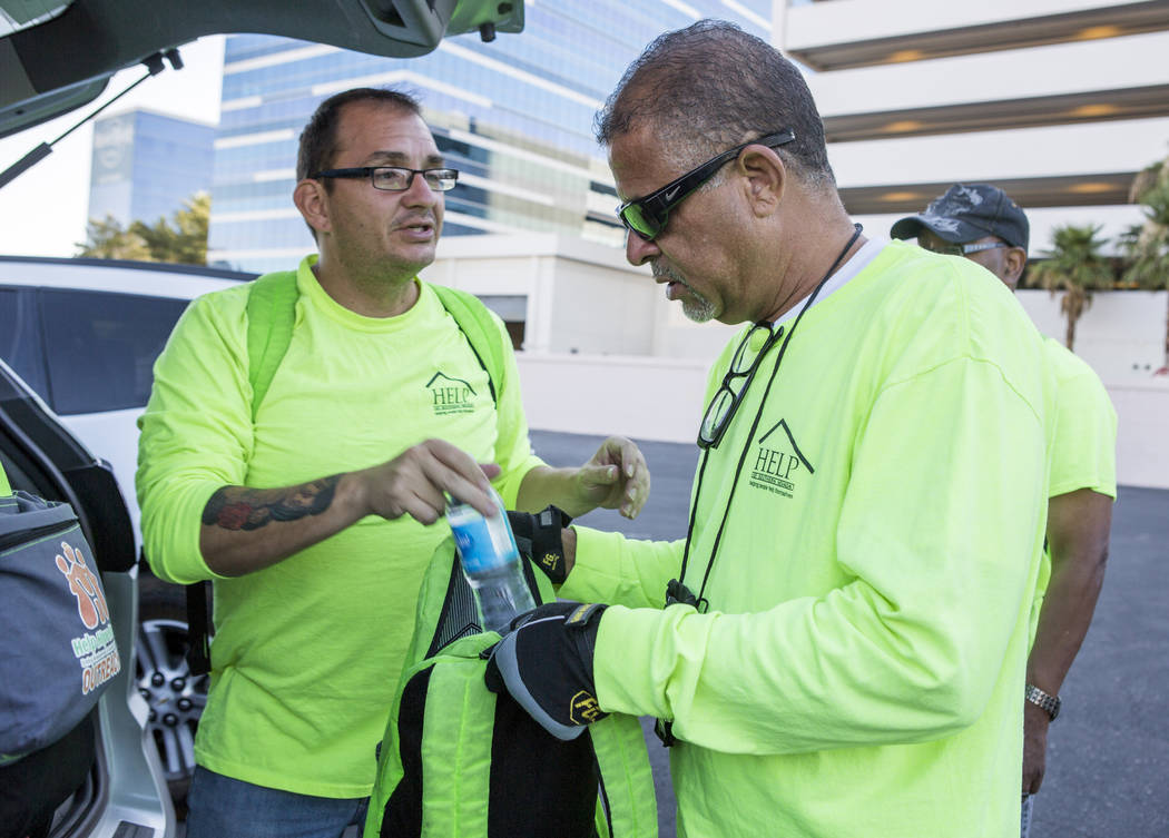 HELP of Southern Nevada employees Louis Lacey, right, and Christie Medina pack water for the homeless in flood tunnels near the Hard Rock hotel-casino on Tuesday, June 27, 2017.  Patrick Connolly  ...