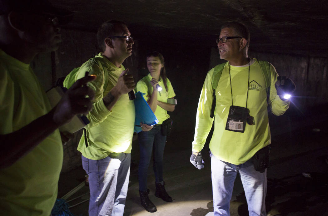 HELP of Southern Nevada employee Louis Lacey, right, instructs his team on what to do next while assisting the homeless in flood tunnels near the Hard Rock hotel-casino on Tuesday, June 27, 2017.  ...