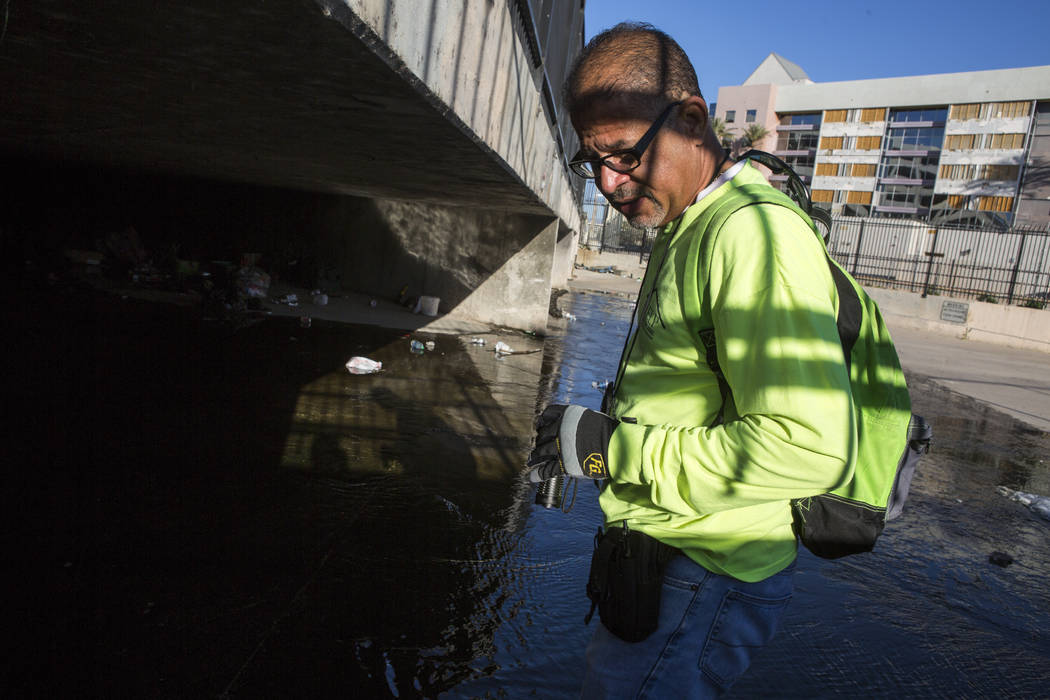 HELP of Southern Nevada employee Louis Lacey, the Mobile Crisis Intervention Team manager, prepares to enter another flood tunnel near the Hard Rock hotel-casino on Tuesday, June 27, 2017.  Patric ...