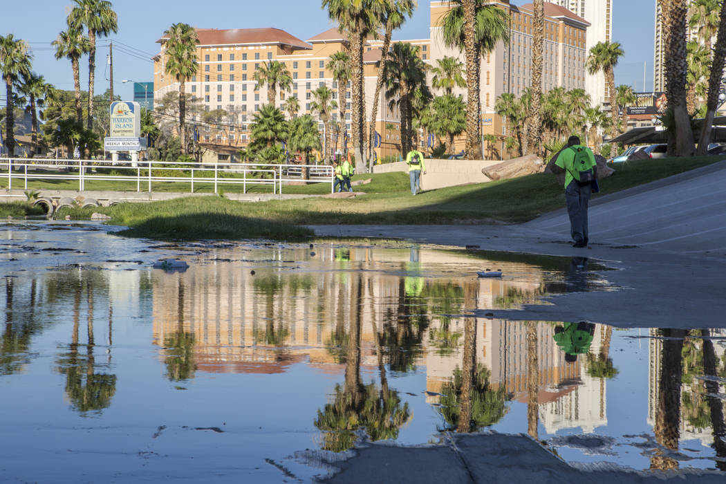 The HELP of Southern Nevada team exits a flood tunnel near the Hard Rock hotel-casino on Tuesday, June 27, 2017.  Patrick Connolly Las Vegas Review-Journal @PConnPie