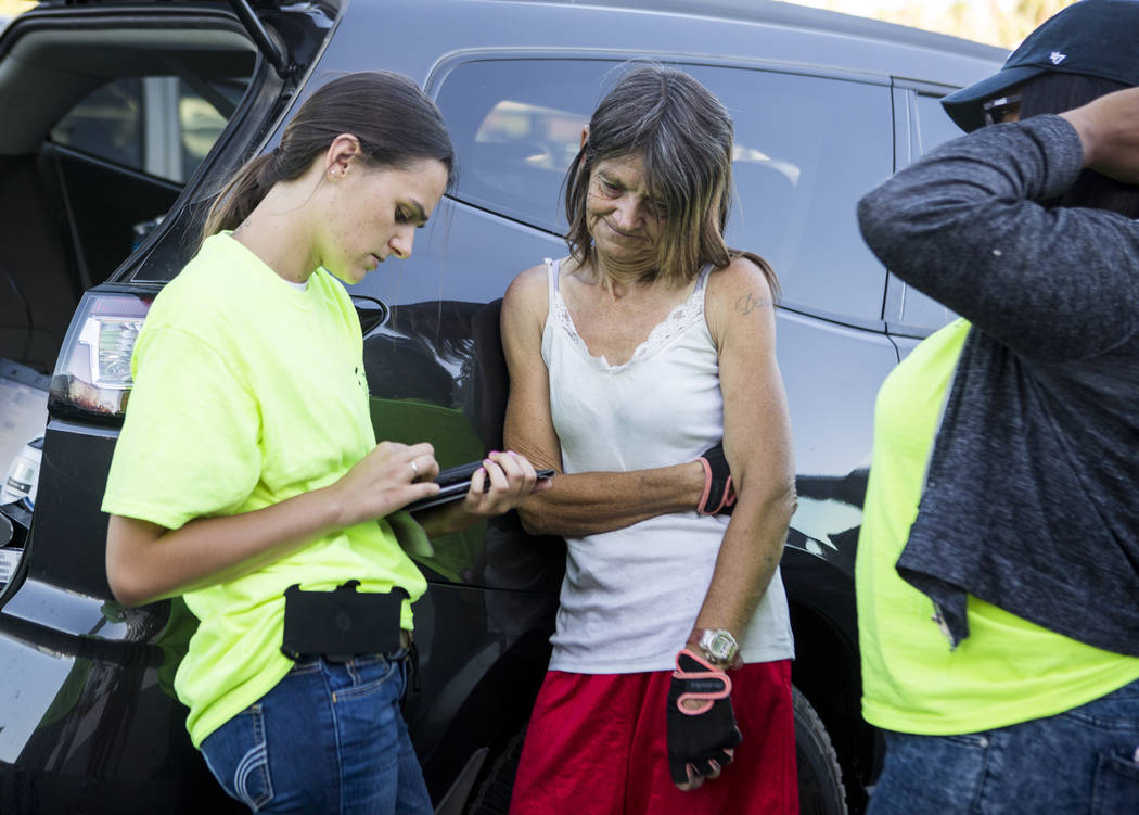 Hayli Petcoff, left, a peer advocate with HELP of Southern Nevada, checks in with Sheila North, who was living in flood tunnels near the Hard Rock hotel-casino, on Tuesday, June 27, 2017.  Patrick ...