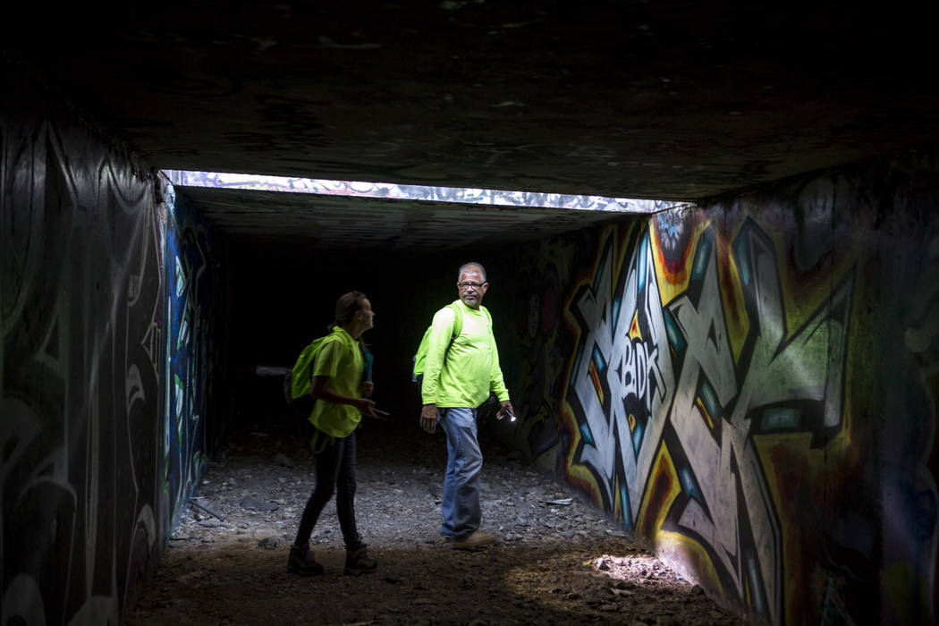 HELP of Southern Nevada employees Louis Lacey and Hayli Petcoff pause in a patch of light underneath Interstate 15 in a flood tunnel near the Hard Rock hotel-casino on Tuesday, June 27, 2017.  Pat ...