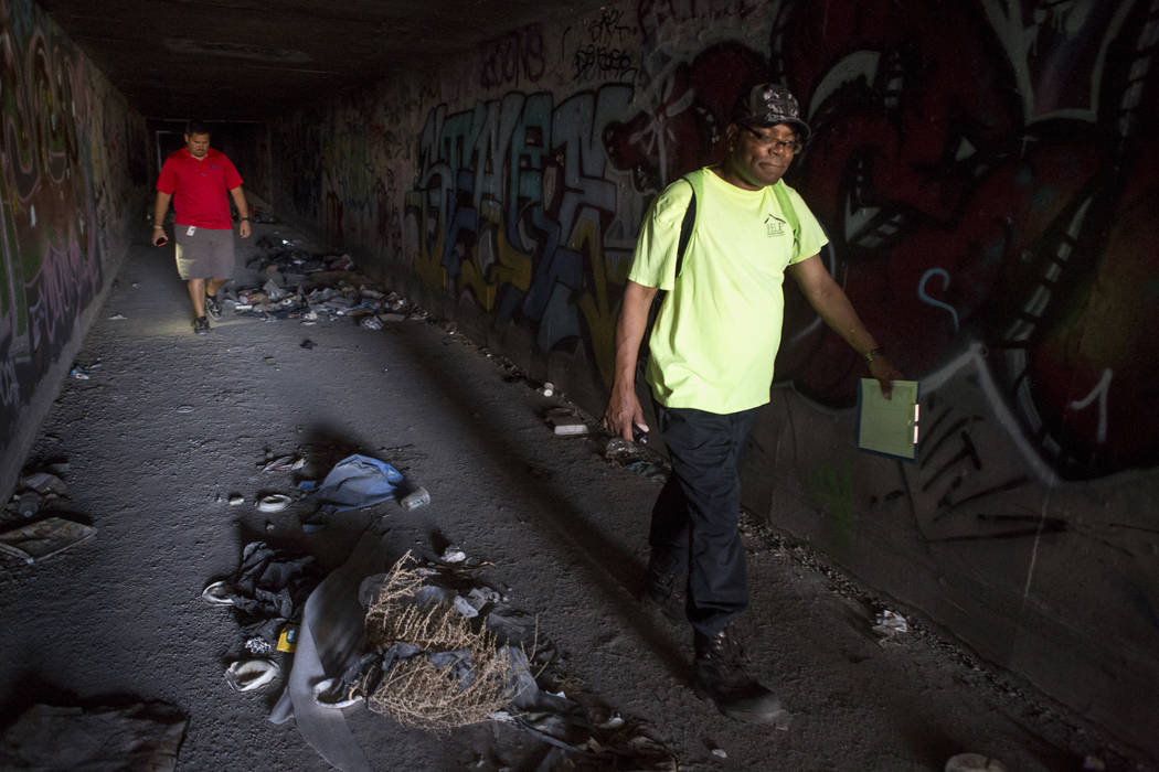 HELP of Southern Nevada employee Walter Poston, right, a Mobile Crisis Intervention Team outreach specialist, walks through a flood tunnel while a U.S. Vets team member follows near the Rio hotel- ...