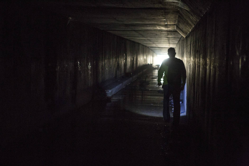 HELP of Southern Nevada employee Louis Lacey, the Mobile Crisis Intervention Team manager, exits a flood tunnel near the Rio casino-hotel on Thursday, June 29, 2017.  Patrick Connolly Las Vegas Re ...