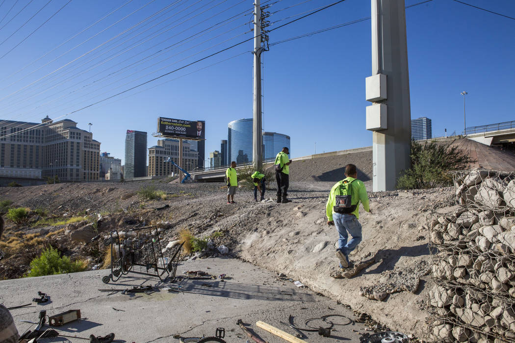 HELP of Southern Nevada's Mobile Crisis Intervention Team climbs up a hill to check on more homeless near the Rio hotel-casino on Thursday, June 29, 2017.  Patrick Connolly Las Vegas Review-Journa ...