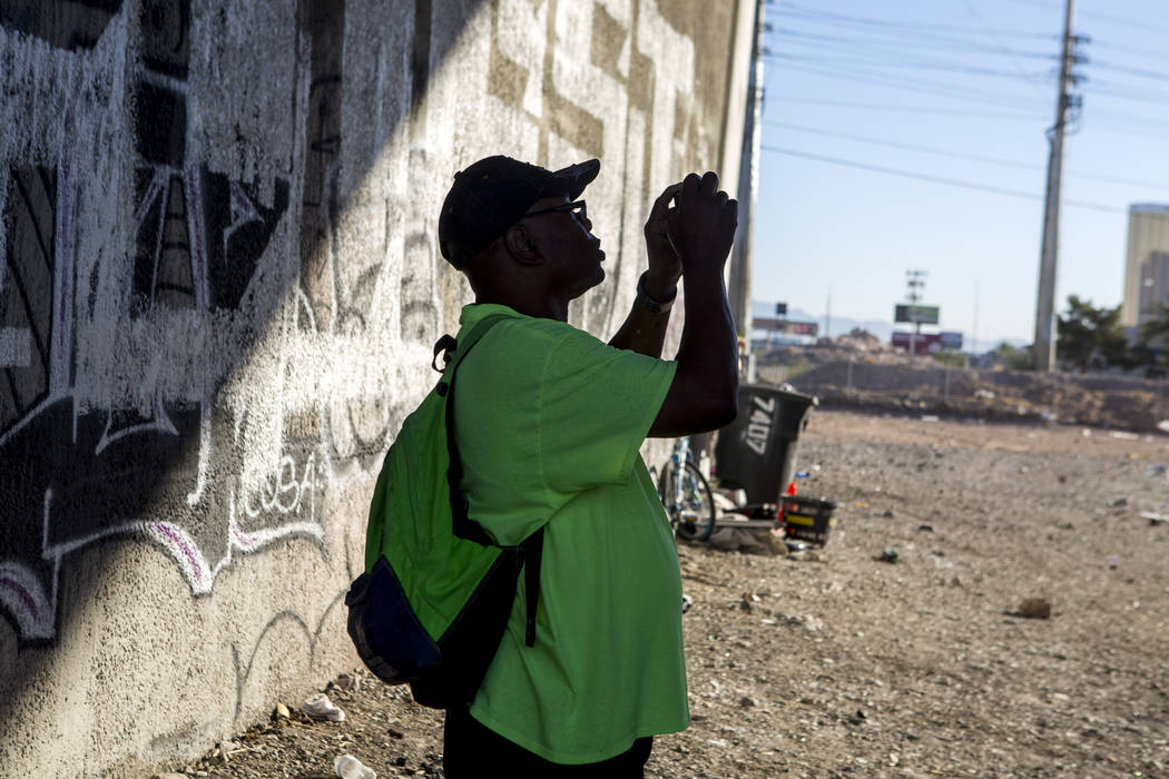 HELP of Southern Nevada employee Walter Poston, a Mobile Crisis Intervention Team outreach specialist, documents a homeless encampment underneath Interstate 15 near the Rio hotel-casino on Thursda ...
