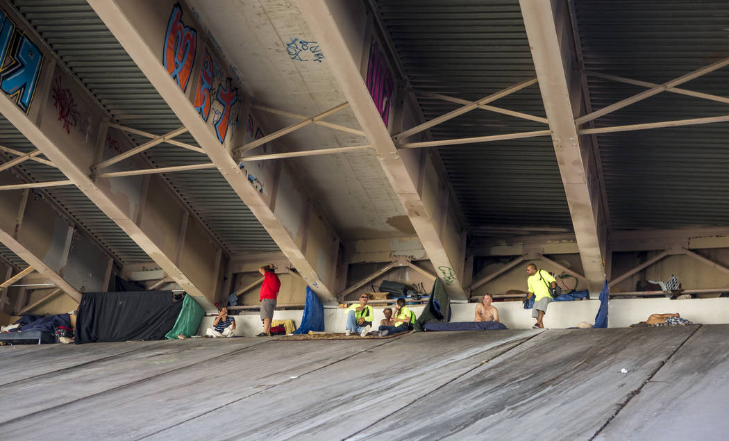 HELP of Southern Nevada and U.S. Vets employees check on homeless people underneath Interstate 15 near the Rio hotel-casino on Thursday, June 29, 2017.  Patrick Connolly Las Vegas Review-Journal @ ...