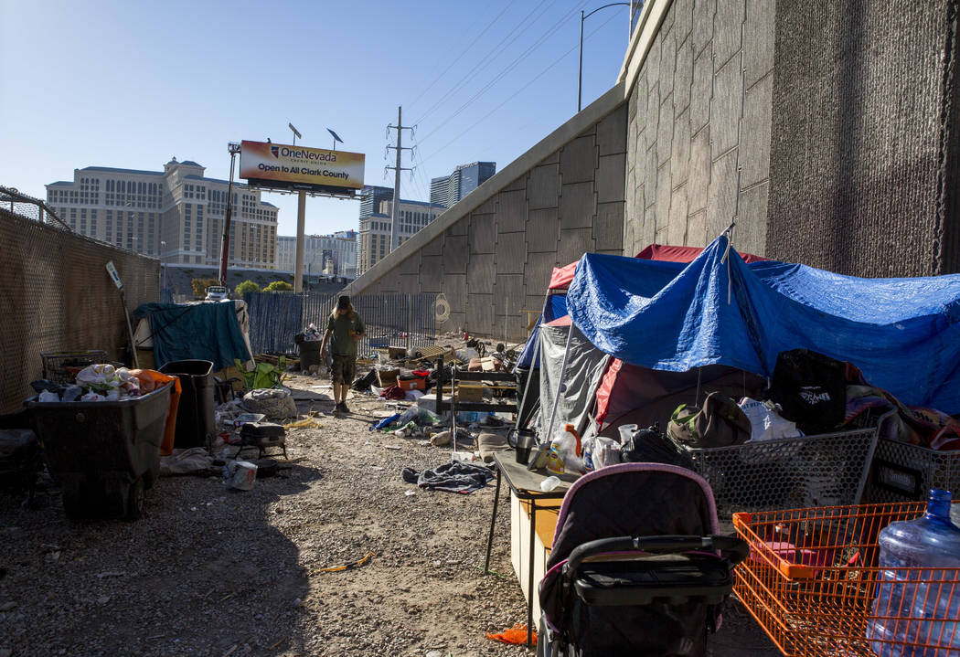 A man who preferred to be called Papa Smurf walks by his tent and shelter near the Rio hotel-casino on Thursday, June 29, 2017.  Patrick Connolly Las Vegas Review-Journal @PConnPie