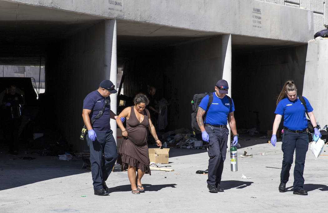 Emergency personnel assists a pregnant woman from an underground drainage tunnel near Dean Drive Martin and Flamingo Road in Las Vegas on Thursday, June 29, 2017. Richard Brian Las Vegas Review-Jo ...