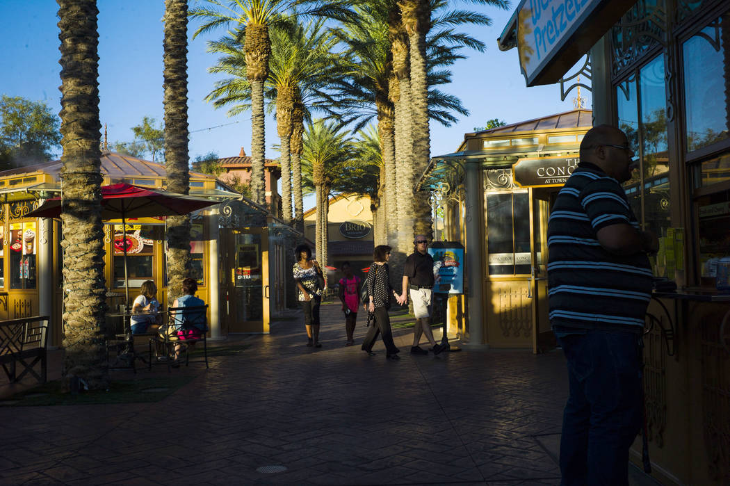 People walk by food stands at Town Square in Las Vegas on Thursday, June 29, 2017. (Chase Stevens/Las Vegas Review-Journal) @csstevensphoto