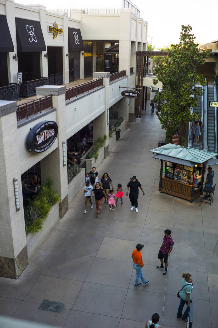 People walk around at Town Square in Las Vegas on Thursday, June 29, 2017. (Chase Stevens/Las Vegas Review-Journal) @csstevensphoto