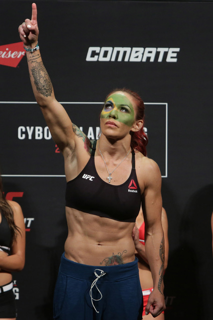 "Brazil's Cristiane Justino, known as ""Cris Cyborg,"" poses during the weigh-in for her UFC Fight Night in Brasilia, Brazil, Friday, Sept. 23, 2016. Their fight is set for Saturday ..."