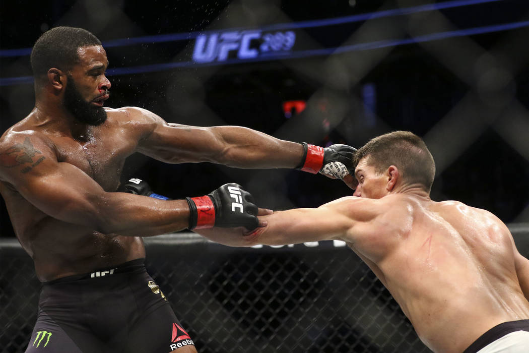 Tyron Woodley of the United States, left, fights Stephen Thompson of the United States during their welterweight title bout at UFC 209 at T-Mobile Arena in Las Vegas on Saturday, March 4, 2017. Wo ...