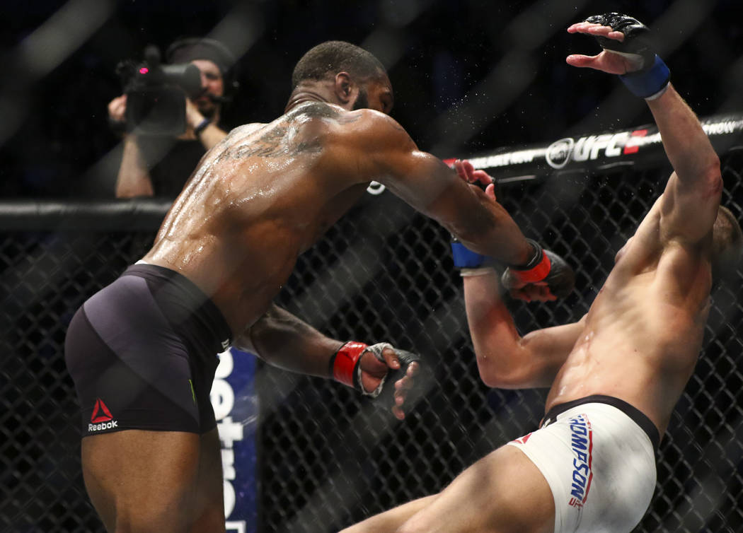 Tyron Woodley of the United States, left, knocks Stephen Thompson of the United States to the mat during their welterweight title bout at UFC 209 at T-Mobile Arena in Las Vegas on Saturday, March  ...