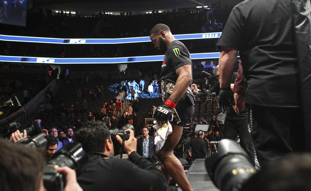 Tyron Woodley of the United States leaves the octagon after defeating Stephen Thompson of the United States via majority decision in their welterweight title bout at UFC 209 at T-Mobile Arena in L ...