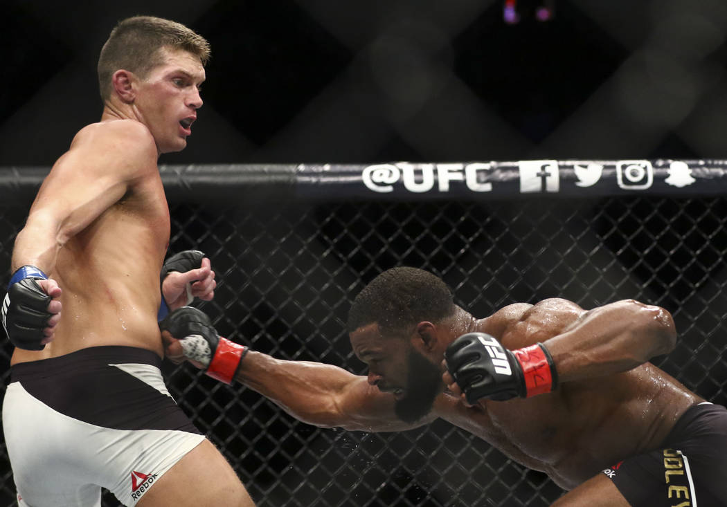 Tyron Woodley of the United States, right, fights Stephen Thompson of the United States during their welterweight title bout at UFC 209 at T-Mobile Arena in Las Vegas on Saturday, March 4, 2017. W ...