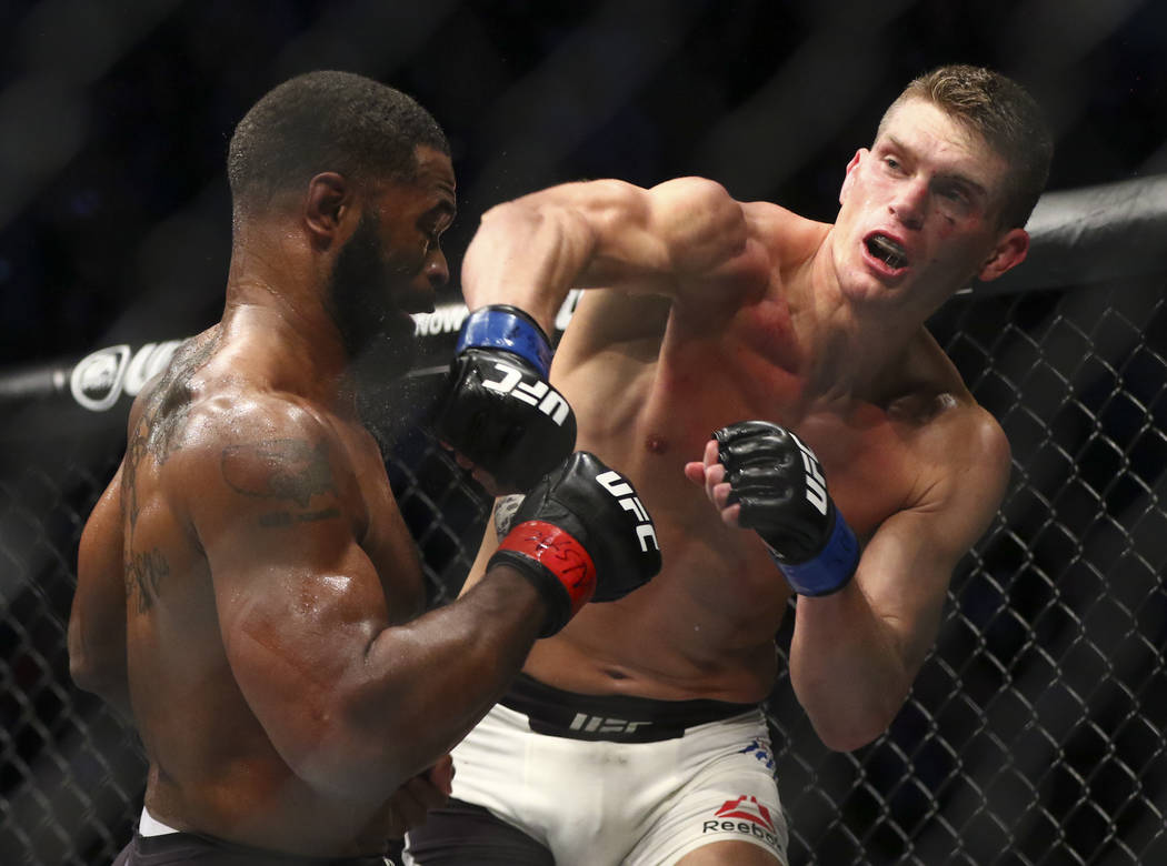 Tyron Woodley of the United States, left, takes a hit from Stephen Thompson of the United States during their welterweight title bout at UFC 209 at T-Mobile Arena in Las Vegas on Saturday, March 4 ...