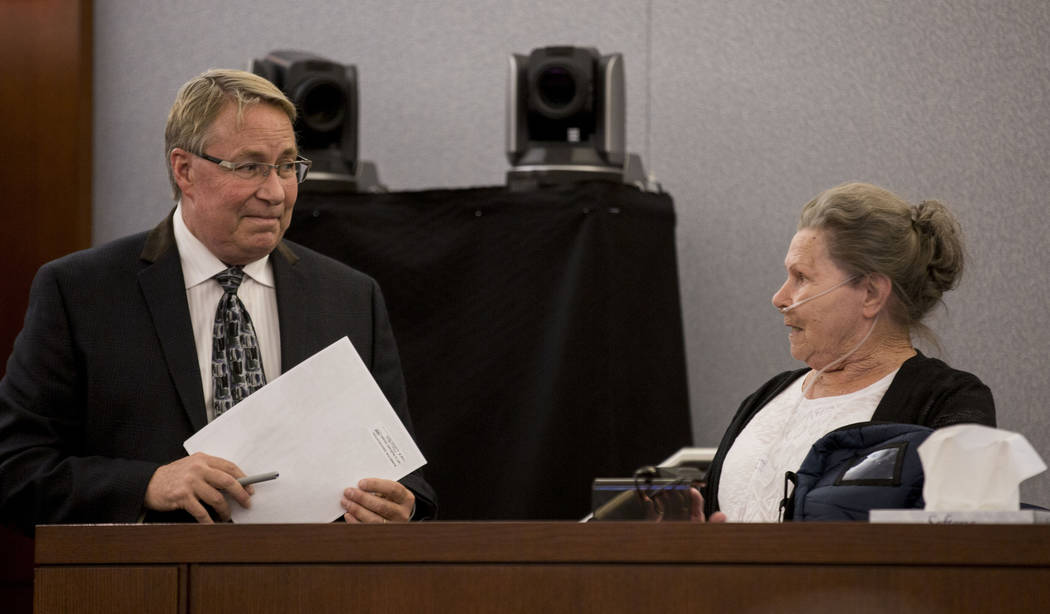 Public defender Randall Pike speaks with Dorothy Arlene Randolph, mother of defendant Thomas Randolph, during Randolph's trial at the Regional Justice Center in Las Vegas, Thursday, June 29, 2017. ...