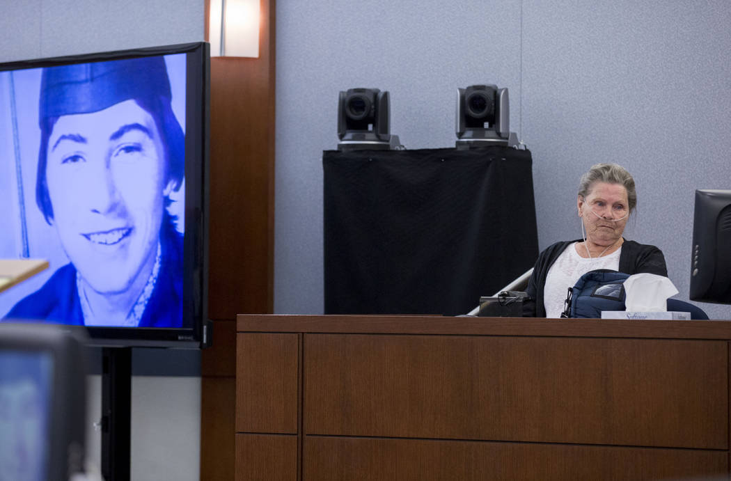 Dorothy Arlene Randolph, mother of defendant Thomas Randolph, looks at a high school graduation photograph of her son during Randolph's trial at the Regional Justice Center in Las Vegas, Thursday, ...