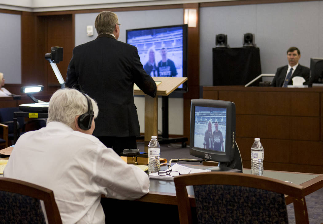 Defendant Thomas Randolph looks at a photograph with his brother Jospeh Randolph during his trial at the Regional Justice Center in Las Vegas, Thursday, June 29, 2017. Elizabeth Brumley Las Vegas  ...