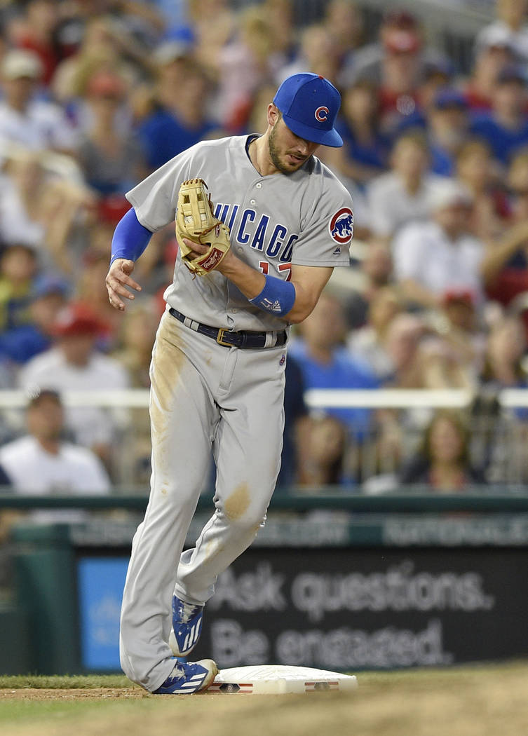 Chicago Cubs third baseman Kris Bryant rolls his foot on the bag after making a catch on a pop-up by Washington Nationals' Matt Wieters during the fifth inning of a baseball game, Wednesday, June  ...