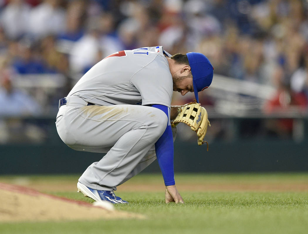 Chicago Cubs third baseman Kris Bryant pauses on the field after he made a catch on a pop-up by Washington Nationals' Matt Wieters during the fifth inning of a baseball game, Wednesday, June 28, 2 ...