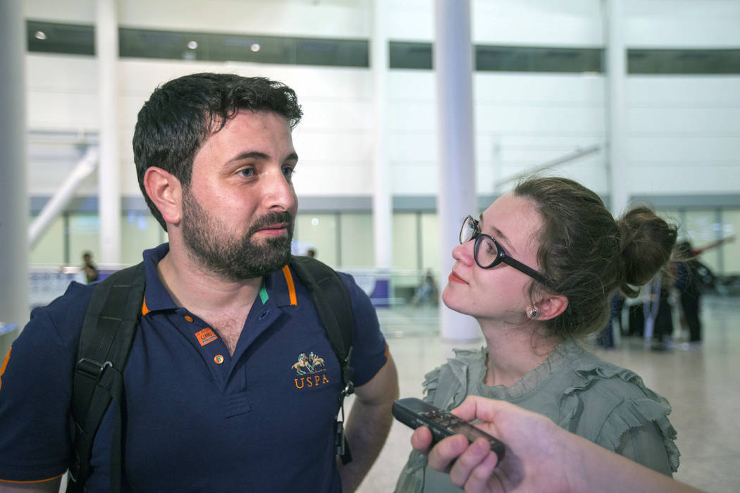 Khaled Almilaji and his wife, Jehan Mouhsen, speak to a reporter after reuniting at Pearson International Airport near Toronto, June 16, 2017. Almilaji, who coordinated a campaign that vaccinated  ...