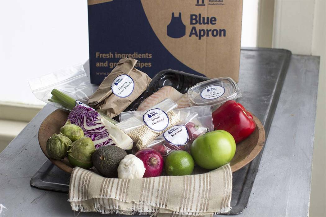 This Oct. 6, 2014, file photo shows an example of a home delivered meal from Blue Apron. (Matthew Mead/AP)
