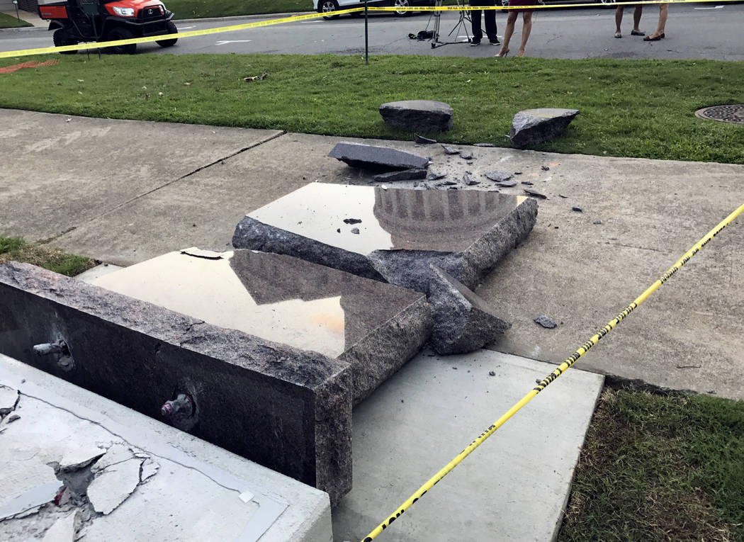 The new Ten Commandments monument outside the state Capitol in Little Rock, Ark., is blocked off Wednesday morning, June 28, 2017, after someone crashed into it with a vehicle, less than 24 hours  ...