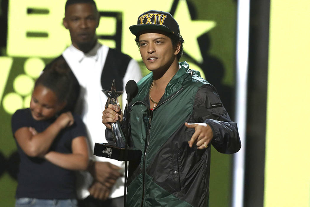 Bruno Mars accepts the award for best male R&B/pop artist at the BET Awards at the Microsoft Theater on Sunday, June 25, 2017, in Los Angeles. (Photo by Matt Sayles/Invision/AP)