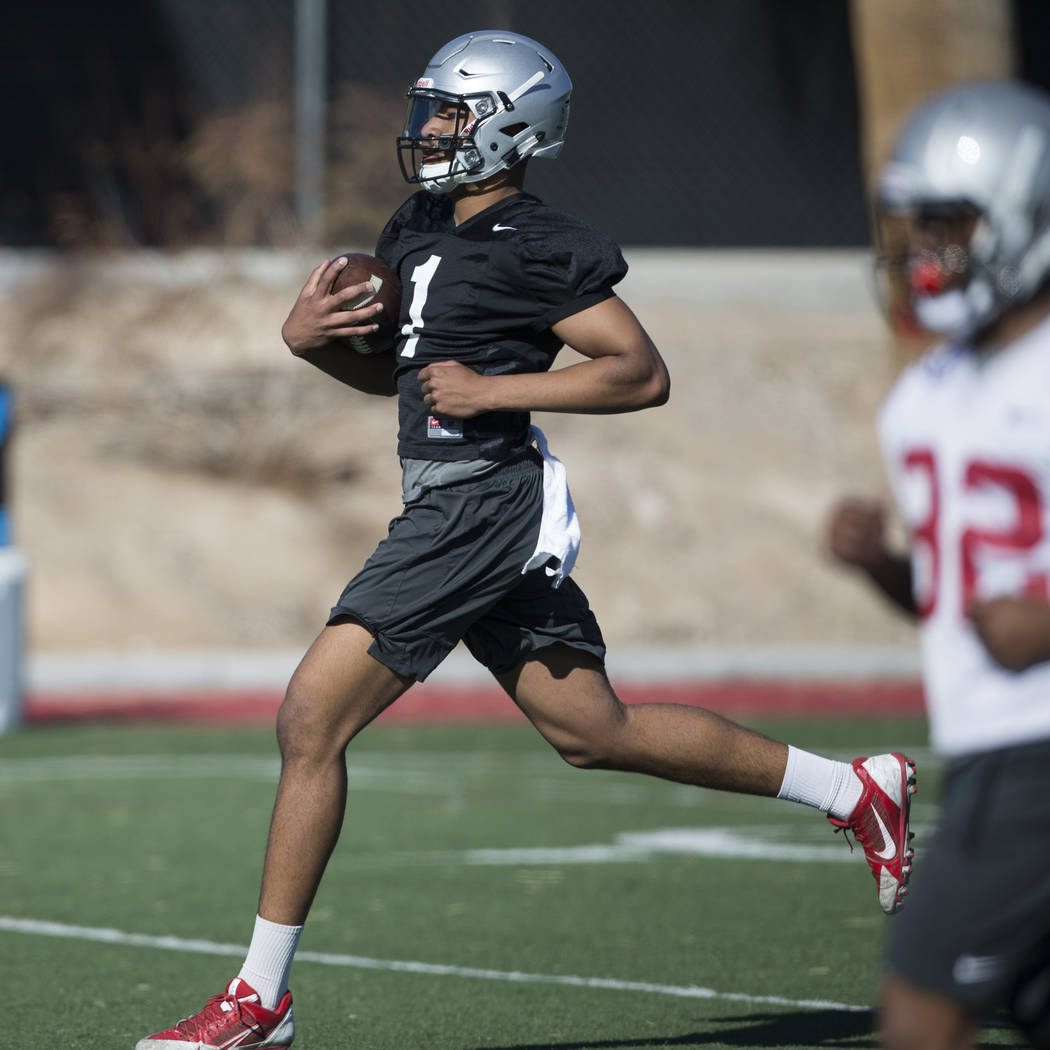 UNLV's quarterback Armani Rogers (1) runs the ball during a team practice at Rebel Park in UNLV on Wednesday, March 1, 2017, in Las Vegas. (Erik Verduzco/Las Vegas Review-Journal) @Erik_Verduzco